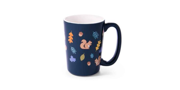 Blue ceramic mug showing pictures of squirrels, leaves and acorns