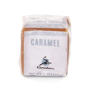 Single cube of Caribou caramel in plastic wrapper