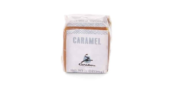 Single cube of Caribou caramel in plastic wrapper