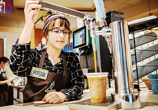 Photo of team member pouring a nitro coffee