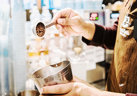 Photo of team member pouring chocolate chips into a container