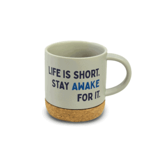 "Beige coffee mug with cork bottom and ""Life is short. Stay awake for it."" text"
