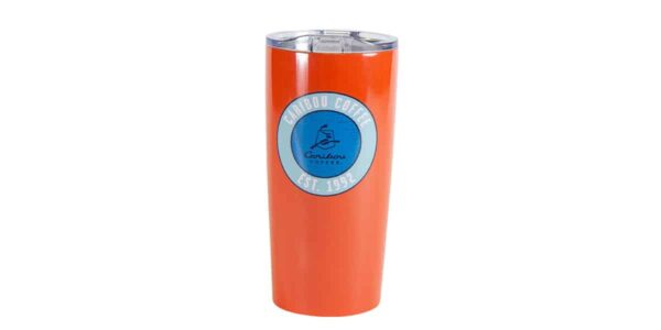 "Orange tall stainless steel tumbler, with ""Caribou Coffee - Est. 1992"" text"