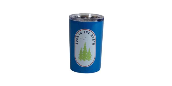 """Short blue tumbler with """"Born in the north"""" text surrounding evergreens"""