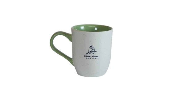 White mug with green interior and Caribou logo