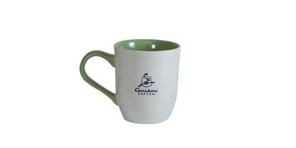 White mug with green interior and Caribou logo