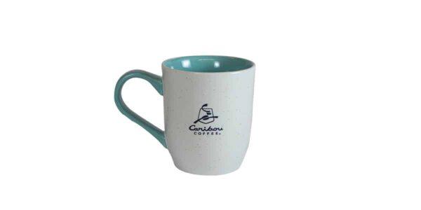 White mug with blue interior and Caribou logo