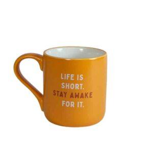 Orange mug with white interior and Caribou slogan