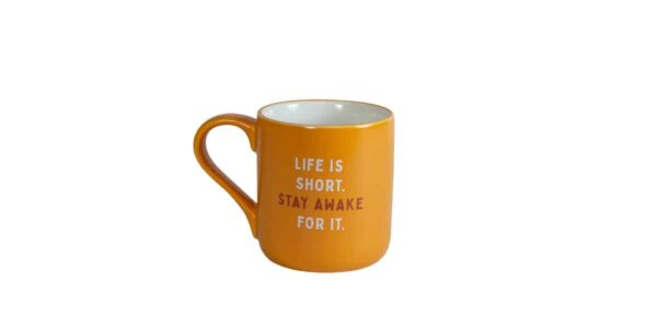 Orange mug with white interior and Caribou slogan