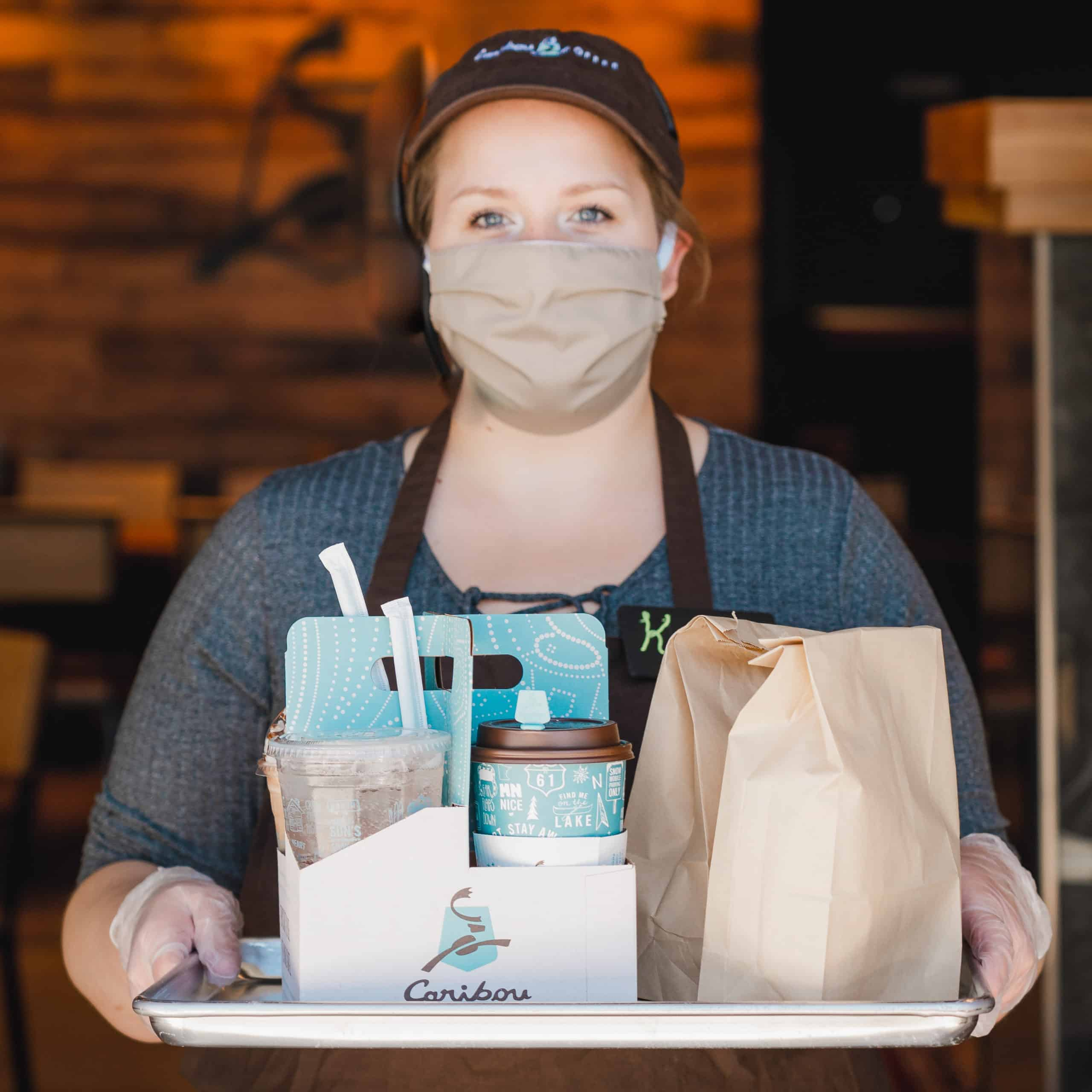 Caribou Employee wearing mask, serving coffee