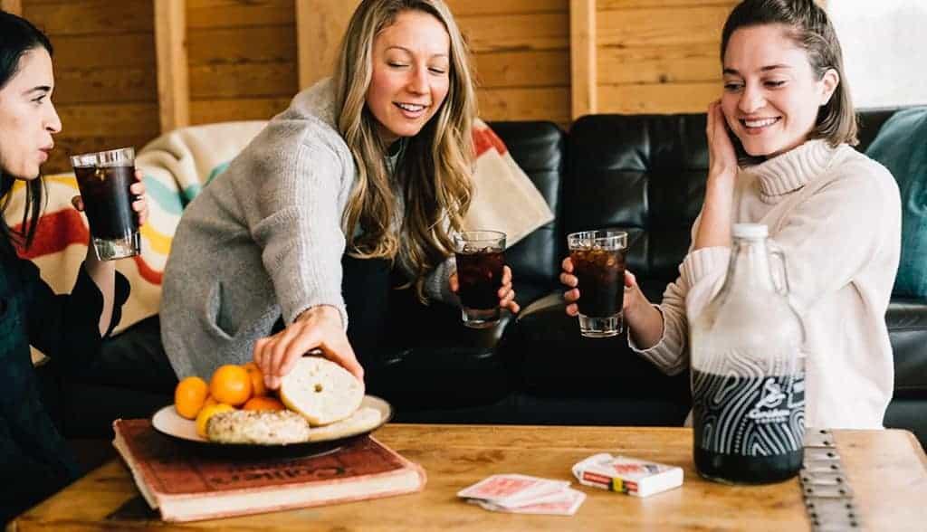 Three girls drinking cold brew coffee